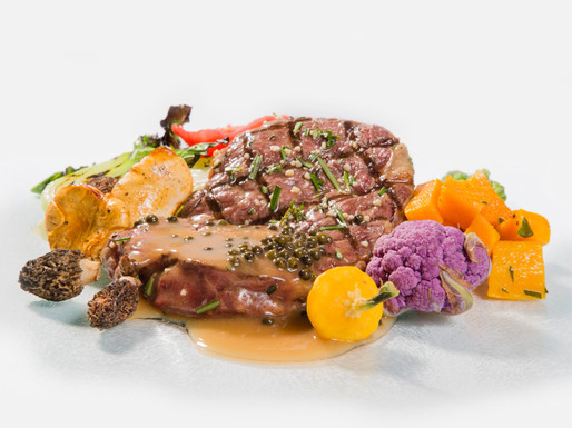 chef style new york style strip with purple cauliflower