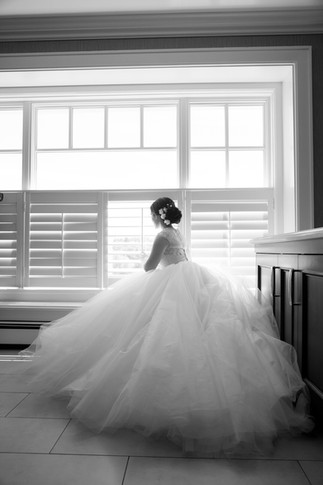 gorgeous Toronto wedding photography by Little Blue Lemon of bride looking out the window in ballgown wedding dress