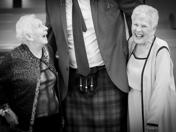 humorous Toronto wedding photography by Little Blue Lemon tall groom with two short grandmothers
