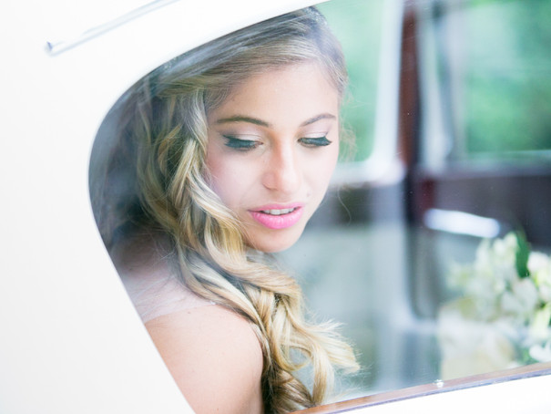 Best wedding photographers in Toronto Little Blue Lemon capture beautiful bride looking through limo window