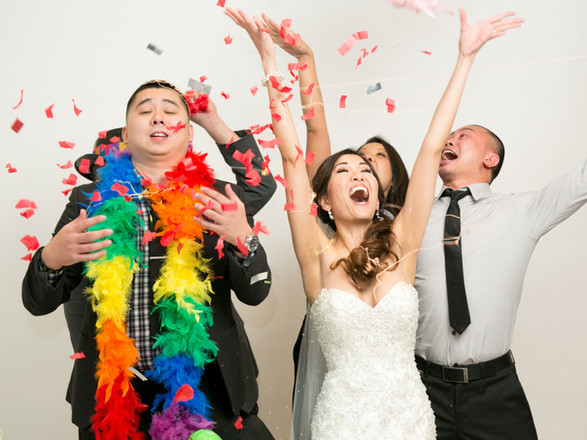 gorgeous Toronto wedding photography by Little Blue Lemon Bride laughing as she throws confetti