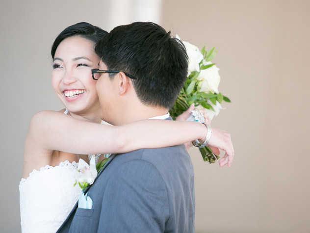 Top wedding photographers Toronto Little Blue Lemon captures a candid embrace between bride and groom