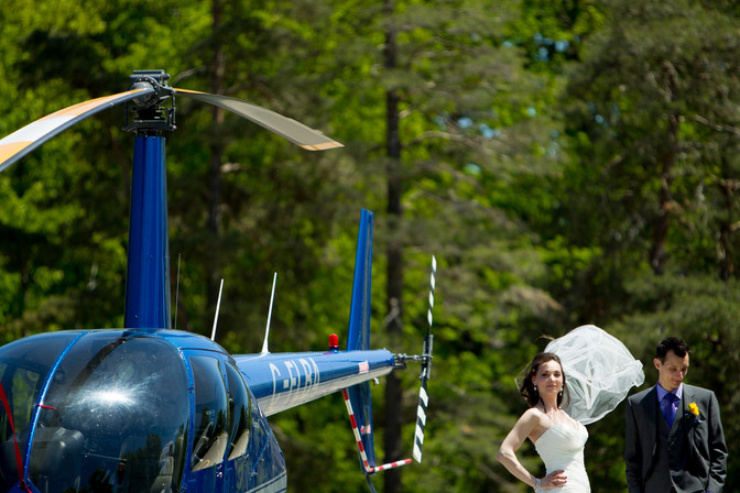 Toronto wedding photographer Little Blue Lemon captures Bride and Groom next to a full size blue helicopter