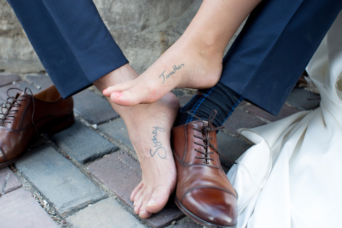 Gorgeous wedding photography by Little Blue Lemon of a Bride & Groom's matching foot Tattoos, The Distillery District, Toronto