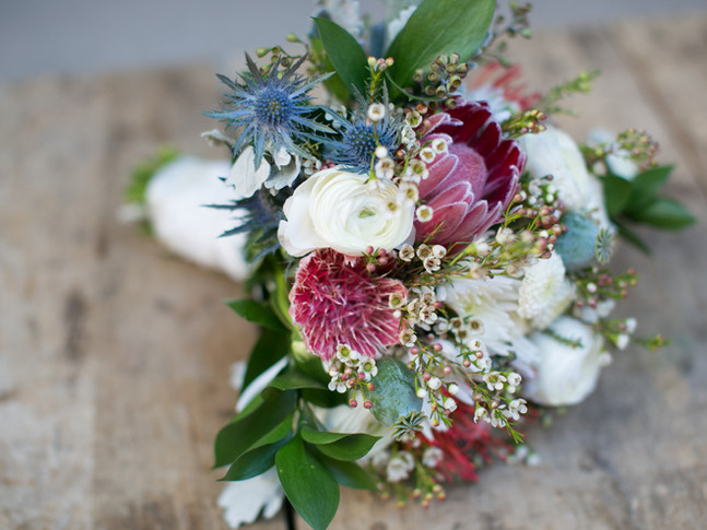Toronto wedding photographers Little Blue Lemon capture rustic bridal bouquet of pink wildflowers