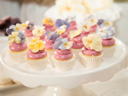 tiny pink cupcakes with decorated edible flowers
