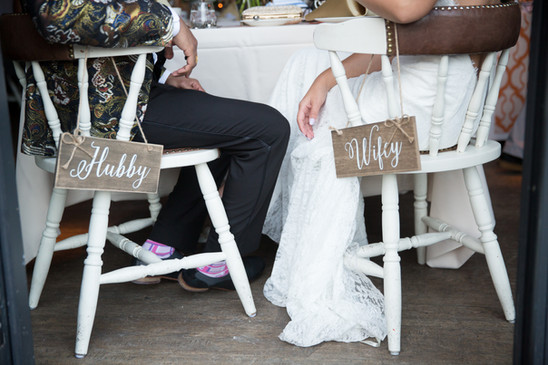 Toronto wedding photographer Little Blue Lemon captures rustic wife and husband signs to hang on reception chairs