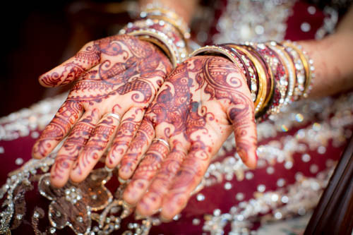 stunning wedding photography by Little Blue Lemon of Indian bride in traditional clothing with beautiful Henna art