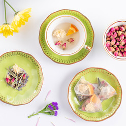 Beautiful artisan tea prepared by Bodhi Tree showcasing Rose Hips, cammomile and orange