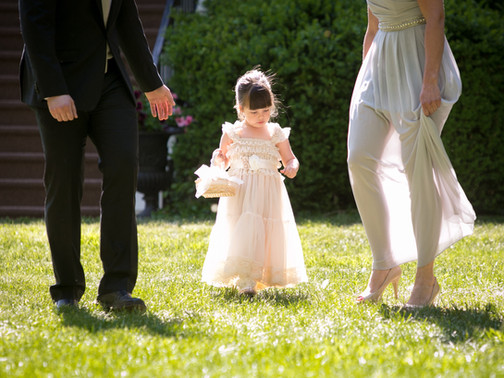 Toronto wedding photographer Little Blue Lemon captures candid moment of a young flower girl
