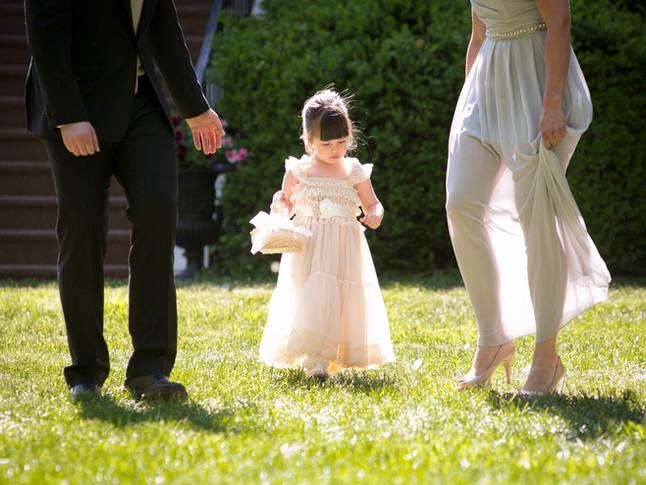 Toronto wedding photographer Little Blue Lemon captures candid moment of a young flower girl