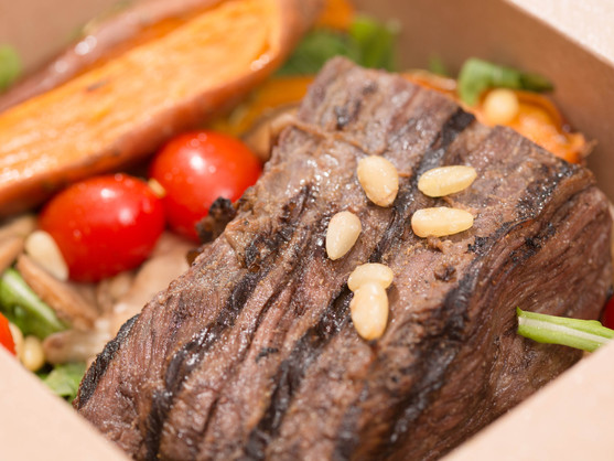 steak with pine nuts on a bed of lettuce