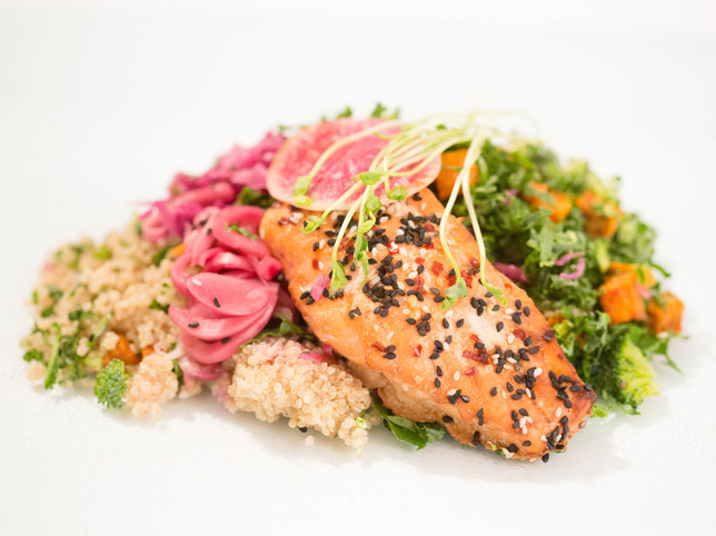 salmon main course with kale and rice
