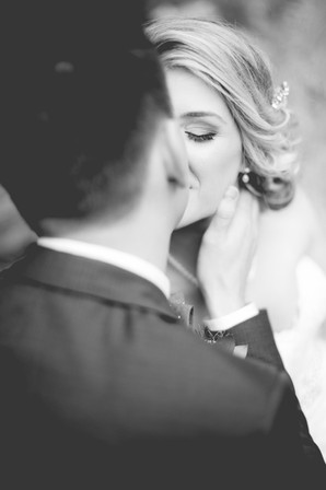 stunning wedding photography by Little Blue Lemon of Groom caressing bride's face Fantasy Farm, Toronto