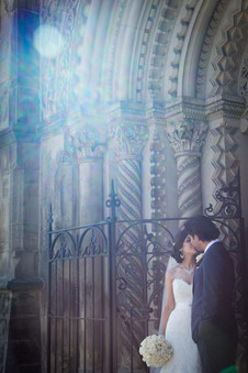 Top wedding photographers Little Blue Lemon captures Bride and Groom in a sun flare archway at historic UofT