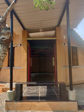 Entrance door with a small seating