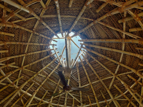 Skylight , Bamboo web made out of Bamboo trusses with weaved palm leafes covering.