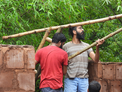 Divij (Architect), working with the volunteers, erecting a Bamboo truss.