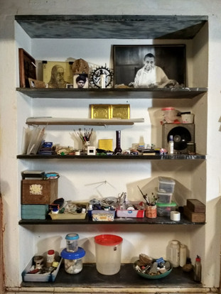 Display of order in disorder.An artists cabinet
