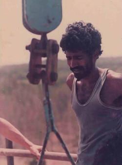 RAMAN WORKING AT THE TOP OF MATRIMANDIR