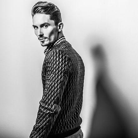 Elegant young handsome man. Black-white