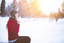 Woman Praying Sitting In Snow
