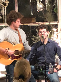 Two young men playing guitar and singing