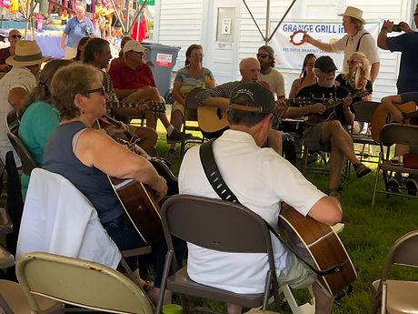 circle of people playing guitar.jpeg