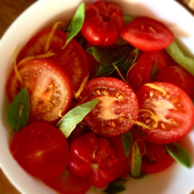 Freshly picked tomato and basil. Ex v o oil , lemon juice and zest