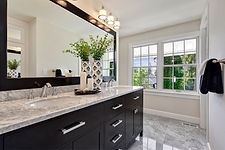 Large mirror paired with sleek cabinetry