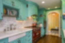 Turquoise cabinets with white backsplash
