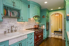 Turquoise cabinets with white backsplash