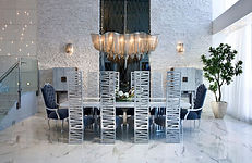 Funky chairs with a cool chandelier