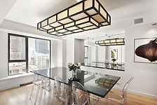 Sleek table with a boxy light fixture