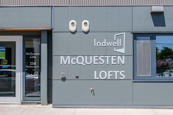 Indwell McQuesten Lofts signage on side of building.