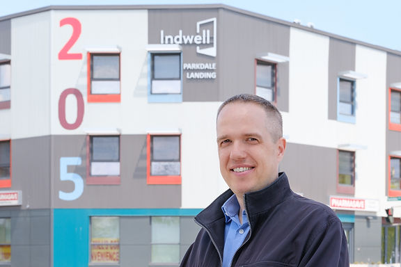 Portrait of Jason Morse standing in front of Indwell's 205 Parkdale Landing Building