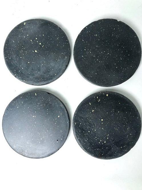 speckled concrete coasters in black