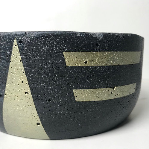 small black concrete plant pot with gold details
