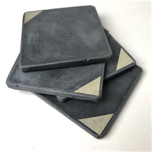 4 concrete coasters in black with gold detailing