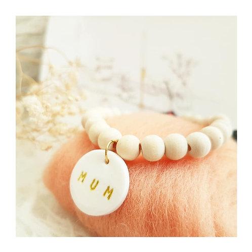 Bracelet perles bois médaillon  et liberty