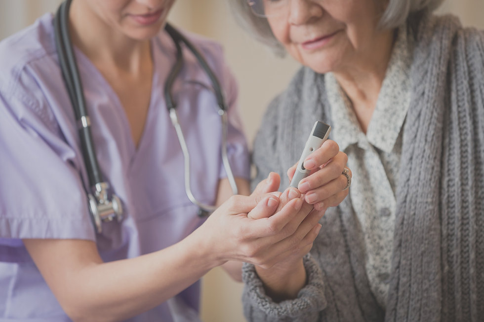 Nurse carrying out a check on an older woman edited