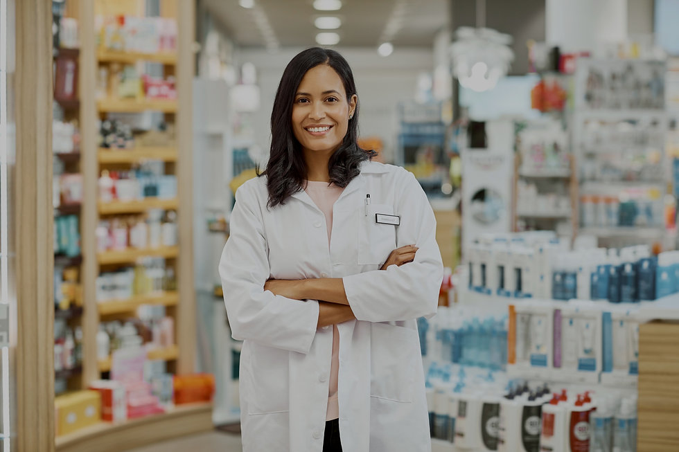 Woman in a lab coat standing in a pharmacy edited