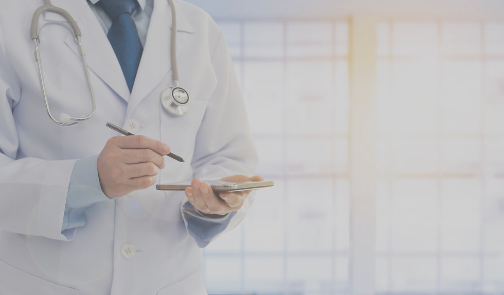 Doctor making notes on a tablet edited