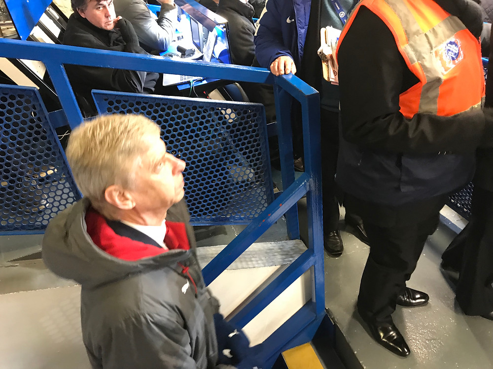 Arsene Wenger in the Chelsea press box. Photo by Paul Lagan