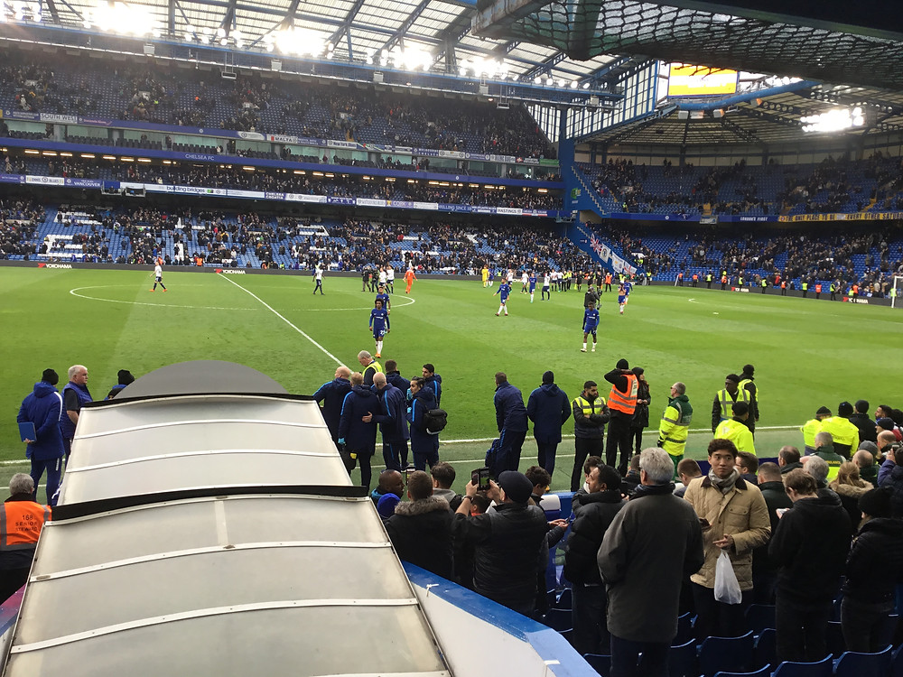 Chelsea players trudge off the Stamford Bridge pitch humbled in 3-1 defeat to Spurs. Photo by Paul Lagan