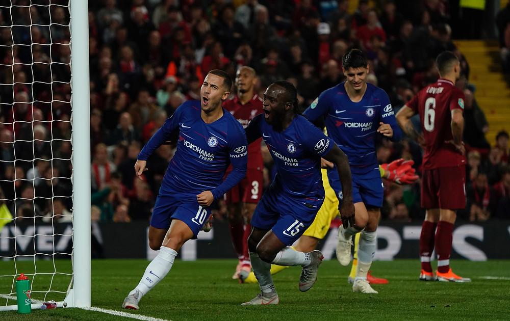 Eden Hazard celebrates his sensational winner at Liverpool tonight Photo Sean Gosling