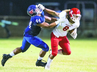 University of Hawaii signs Kahuku football star [ @NaluEmerson ]