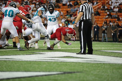 Kahuku running back Elvis Vakapuna falls into the end zone for the first score of the game. Photo by