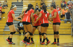 Kahuku players celebrate a point in the second set.
