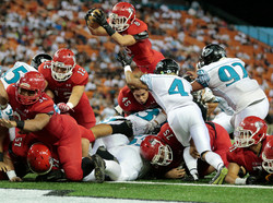 Harmon Brown (8) soars over the goal line for a touchdown